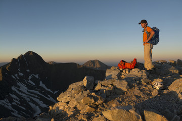 A man camping on the summit of Little Bear Peak, Alamosa, Colorado.