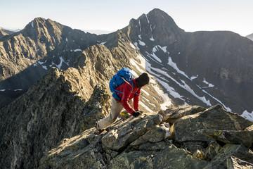 A man climbing Little Bear Peak, Alamosa, Colorado.