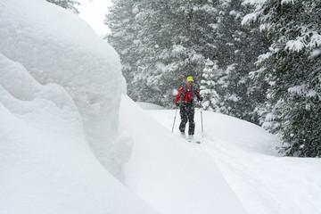 A man backcountry skiing  above Red Mountain Pass, Silverton, Colorado.