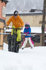 A mother towing her daughter to the local ski resort, Silverton, Colorado.