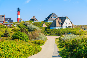 Fototapete - Road to lighthouse in Hornum village on southern coast of Sylt island, Germany