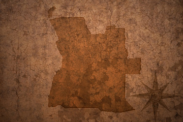 angola map on a old vintage crack paper background