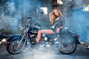 Pretty woman on the motorcycle.