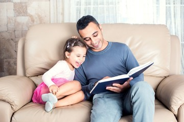 Little Girl And Father Reading Book
