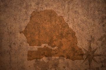 senegal map on a old vintage crack paper background