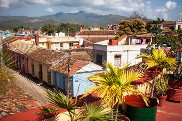 Brightly colored walls and terraces can be seen from a rooftop.