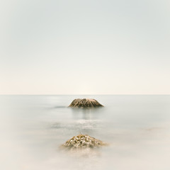 Seascape with single rock