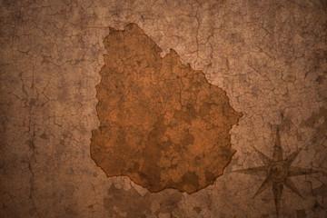 uruguay map on a old vintage crack paper background