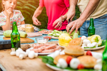 Couple preparing food for barbecue