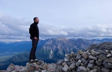 Man on mountain top. Candian Rocky Mountains. Canada.