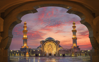 In framming the mosque with beautiful sunset light