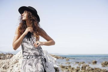 bohemian girl in hat outdoors potrtait