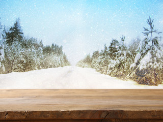 Empty table in front of dreamy winter landscape background
