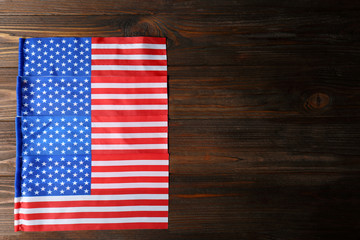 American flags on wooden background