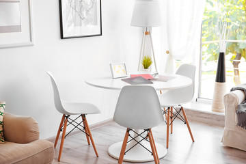 Beautiful modern interior with  white table and chairs near window