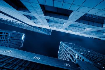 Modern Buildings Against Sky at night.