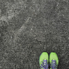 top of green exercise shoes stand of the corner of picture with concrete background