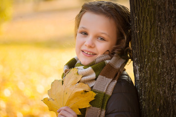 Autumn girl  portrait smiling outdoors at the park