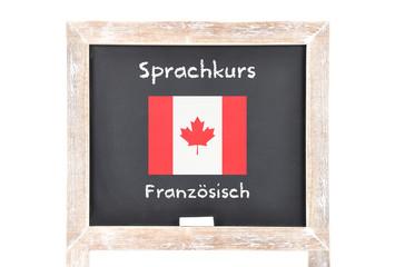 Sprachkurs mit Flagge auf Tafel