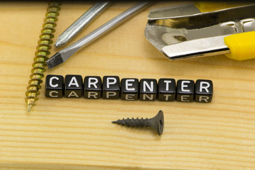 The concept of profession carpenter on wood background