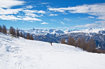 skiing and snowboarding in sunny weather
