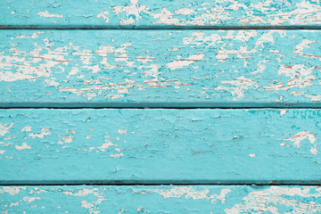 Old wooden planks with cracked blue paint
