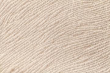 Ivory background from soft textile material. Fabric with natural texture.
