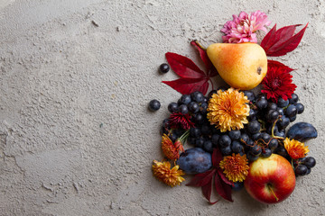 Autumn fruits and vegetables on stone background