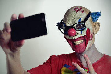 evil clown taking a selfie