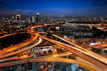 Traffic and light trails on the a highway loop at bangkok, Thailand
