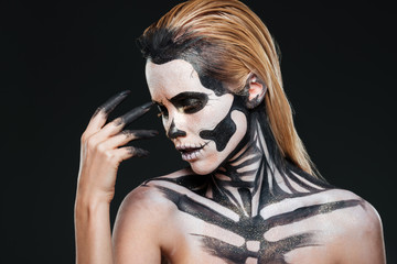 Portrait of woman with blonde hair and halloween skeleton makeup