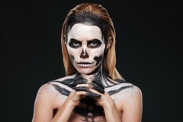 Woman with frightening skeleton makeup