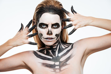 Closeup of woman with gothic terrifying makeup posing