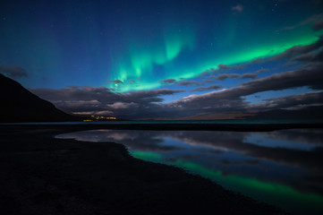 Wall Mural - Northern lights dancing over calm lake in Abisko national park