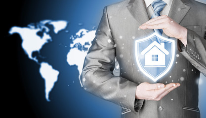 House protection and insurance. Home shield. Real estate safety. World map background. Worldwide insurance.