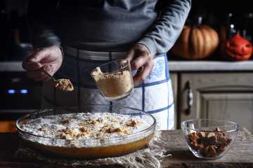 Adding grated crackers in the dough for pumpkin dump cake
