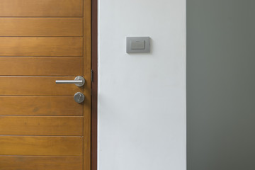 abstract scene of wood door and lighting switch on wall