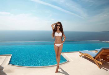 Beautiful sexy woman bikini model with long healthy hair, brunet