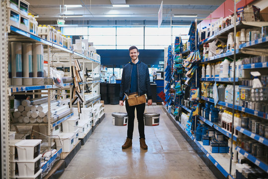 Young handyman posing in a hardware store