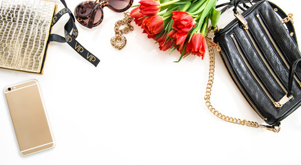 Fashion flat lay with accessories, flowers, phone