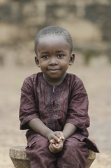 Handsome young African boy smiling happily outdoors (Peace for Africa)