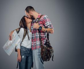 Urban couple kissing.
