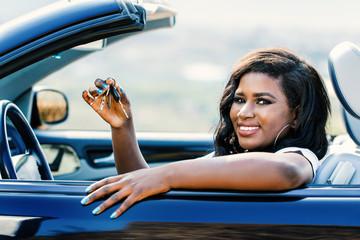 African female driver showing car keys.