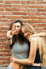 Two young crazy girls having fun