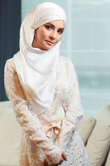 beautiful Muslim woman in a white wedding dress