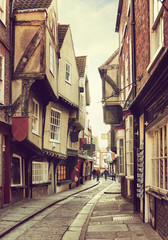 The Shambles, a medieval street in York, England, UK.  Toned image. Added grunge texture