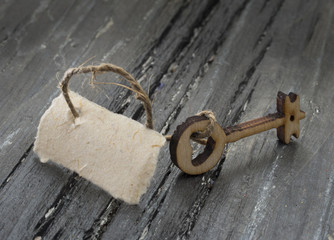 vintage key with blank paper tag