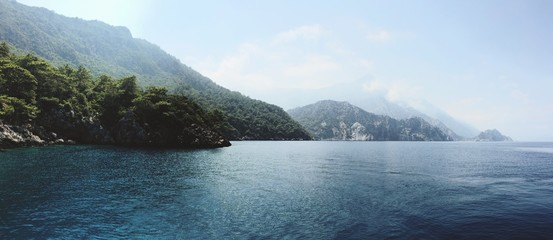 Panoramic View Of Mountains By Sea Against Sky