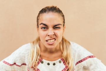 Angry young blonde woman looking at camera