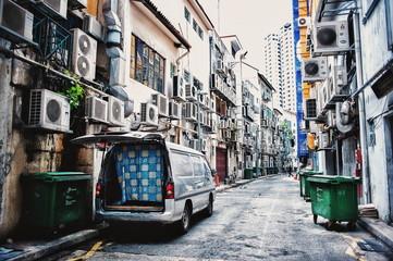Van Parked On Street Amidst Residential Buildings